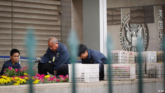 Gardeners work at the side walk along the U.S. Embassy in Beijing, China, Tuesday, May 1, 2012. A friend of blind Chinese activist Chen Guangcheng says police have acknowledged to him that Chen did not break any laws by escaping from house arrest and apparently entering the U.S. Embassy. (AP Photo/ Vincent Thian)