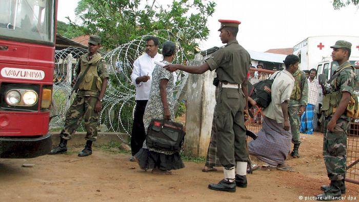 Civilians who have fled from Liberation Tigers of Tamil Eelam (LTTE) controlled areas arrive at an aid camp near Vavuniya