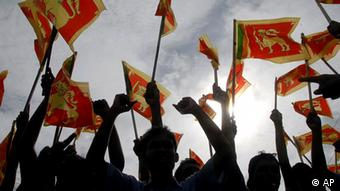 Sri Lankans wave their national flag during a victory rally to celebrate the defeat of the Tamil Tiger rebels, in Colombo, Sri Lanka, Friday, May 22, 2009. (AP Photo)