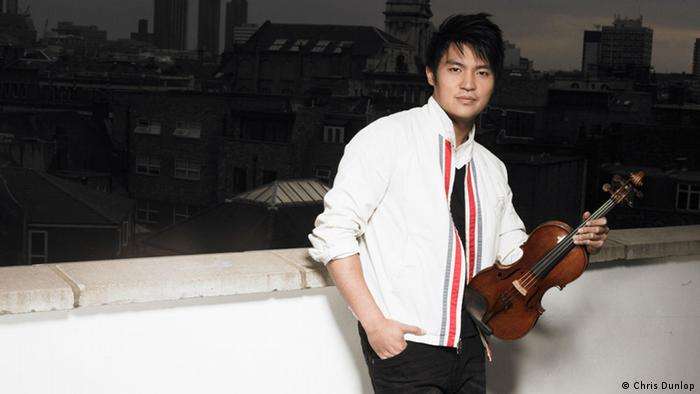 Violinist Ray Chen holding his violin