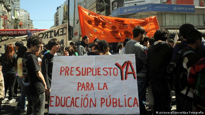 A picture dated 14 September 2010 shows students holding a banner claiming more budget in public education on steets in Buenos Aires. The education crisis of secondary school and university students in demand for building improvements in educational facilities.