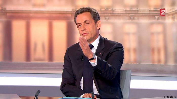 Nicolas Sarkozy, France's President and UMP candidate for his re-election, for the 2012 French presidential elections, is seen in this video grab from France 2 Television, during a televised debate with Francois Hollande (not pictured), the Socialist party candidate in La Plaine Saint-Denis, near Paris, May 2, 2012. REUTERS/France 2 Television/Handout (FRANCE - Tags: POLITICS ELECTIONS MEDIA) THIS IMAGE HAS BEEN SUPPLIED BY A THIRD PARTY. IT IS DISTRIBUTED, EXACTLY AS RECEIVED BY REUTERS, AS A SERVICE TO CLIENTS