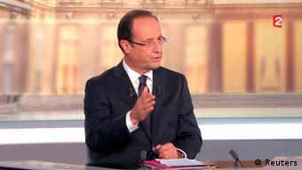 Francois Hollande, Socialist party candidate for the 2012 French presidential elections, is seen in this video grab from France 2 Television, during a televised debate with Nicolas Sarkozy (not pictured), France's President and UMP candidate for his re-election, in La Plaine Saint-Denis, near Paris, May 2, 2012. REUTERS/France 2 Television/Handout (FRANCE - Tags: POLITICS ELECTIONS MEDIA) THIS IMAGE HAS BEEN SUPPLIED BY A THIRD PARTY. IT IS DISTRIBUTED, EXACTLY AS RECEIVED BY REUTERS, AS A SERVICE TO CLIENTS