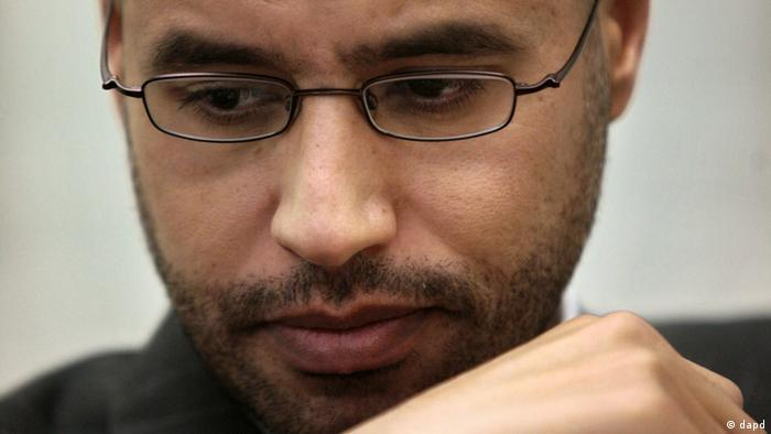 In this Friday, Nov. 21, 2008 file photo, Saif al-Islam Gadhafi, the son of Libyan leader Moammar Gadhafi, poses during an interview in New York. Moammar Gadhafi's son Seif al-Islam, the only wanted member of the ousted ruling family to remain at large, was captured as he traveled with aides in a convoy in Libya's southern desert, Libyan officials said Saturday Nov 19, 2011. (Photo: Bebeto Matthews, File/AP/dapd)