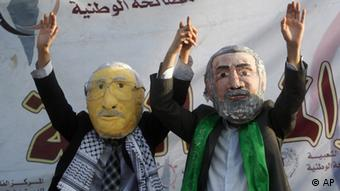 Palestinians wearing masks at demonstration calling for Palestinian unity