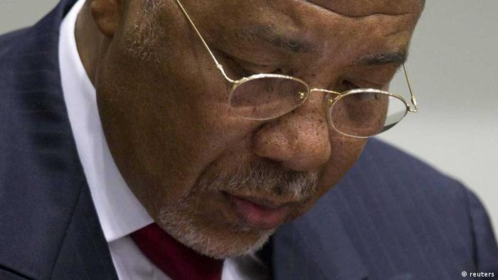 Former Liberian President Charles Taylor looks down as he waits for the start of a hearing