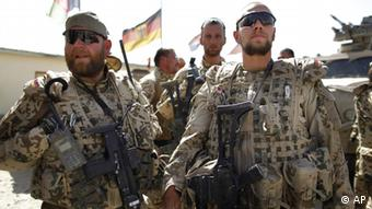 German ISAF soldiers arrives back to the base after patrolling with their unit the area around Feyzabad, east of Kunduz, Afghanistan, Saturday, Sept. 19, 2009. (ddp images/AP Photo/Anja Niedringhaus)