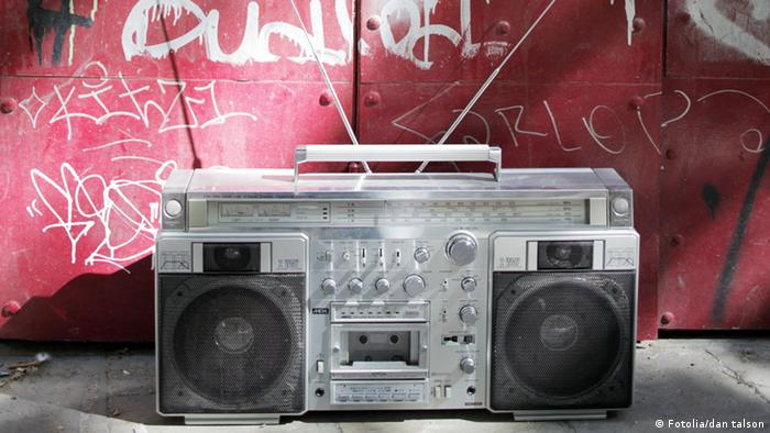 A retro ghetto blaster shot outdoors in urban setting
