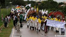Bolivian Amazonic indigenous people participate in a protest march in Trinidad, Beni province, in the Amazonic region of Bolivia, April 27, 2012. The indigenous people of the territory of national park Isiboro Secure, known by its Spanish acronym TIPNIS, arrived to Trinidad to begin a new march to La Paz to defend their territory against the planned construction of a highway through the middle of the park. The banner reads, San Ignacio residents require the construction of the highway, but demand (that the) government respects the heart of the TIPNIS. REUTERS/David Mercado (BOLIVIA - Tags: ENVIRONMENT POLITICS CIVIL UNREST)