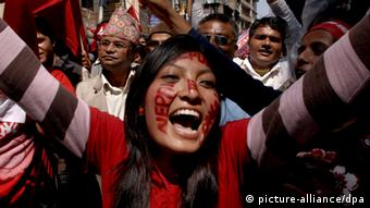 A young Nepalese girl with the words 'Nepal Republic' painted on her face, takes part in a victory rally outside the Narayanhiti royal palace after the royal flag was removed from the Royal palace in Kathmandu, Nepal. 29 May 2008 (Photo: EPA/NARENDRA SHRESTHA +++(c) dpa - Report+++)