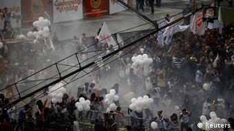A view shows the crowd right after the explosion of gas-filled balloons during a campaign rally