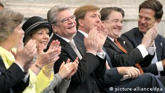 Gauck and other audience members at a Liberation Day ceremony, including Prince Willem Alexander
