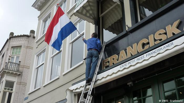 A Dutch flag is hung on Liberation Day