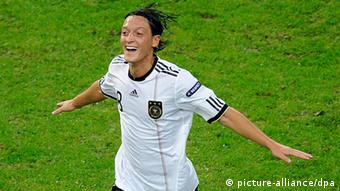Germany's Mesut Oezil celebrates after scoring the 1-0 goal during the Group A EURO 2012 qualifying match between Germany and Belgium at the Esprit Arena in Duesseldorf, Germany, 11 October 2011. (Photo via dpa)