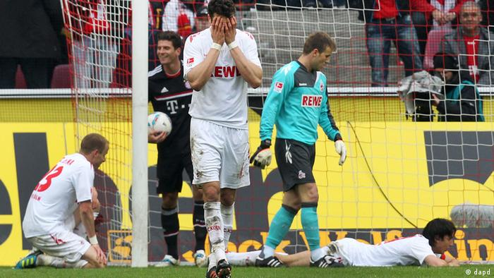 Cologne's players react after an own goal giving Munich a 2-0 lead