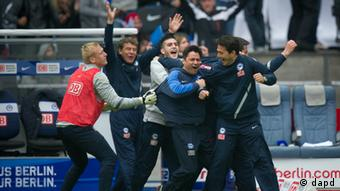 Hertha's coach and other staff celebrate the final whistle against Hoffenheim