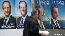 A man walks past official campaign posters for Socialist Party candidate Francois Hollande (L) and French President and UMP political party candidate Nicolas Sarkozy (R) which are displayed on electoral panels in Tulle, May 5, 2012. France goes to the polls on Sunday for the second round of their presidential election. REUTERS/Regis Duvignau (FRANCE - Tags: POLITICS ELECTIONS)