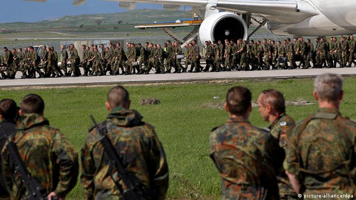 About 250 German NATO peacekeepers arrive by plane at Pristina's airport, Kosovo, 25 April 2012, as part of 700 troops sent to reinforce soldiers the NATO peacekeeping mission in Kosovo (KFOR)(Photo: EPA/VALDRIN XHEMAJ)