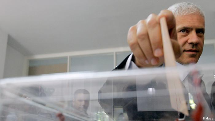 Close-up of Tadic casting his ballot at a polling station