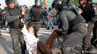 Russian riot police detain a participant during a march of the million opposition protest in central Moscow May 6, 2012. Photo: REUTERS/Denis Sinyakov