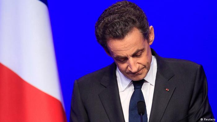 Nicolas Sarkozy, France's incumbent president, reacts after his defeat for re-election in the second round vote of the 2012 French presidential elections as he appears on stage before UMP party supporters at the Mutualite meeting hall in Paris May 6, 2012.