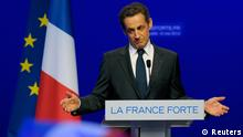 Nicolas Sarkozy, France's incumbent president, reacts after his defeat for re-election in the second round vote of the 2012 French presidential elections as he appears on stage before UMP party supporters at the Mutualite meeting hall in Paris May 6, 2012. REUTERS/Philippe Wojazer (FRANCE ELECTION - Tags: POLITICS ELECTIONS TPX IMAGES OF THE DAY) ELECTION)