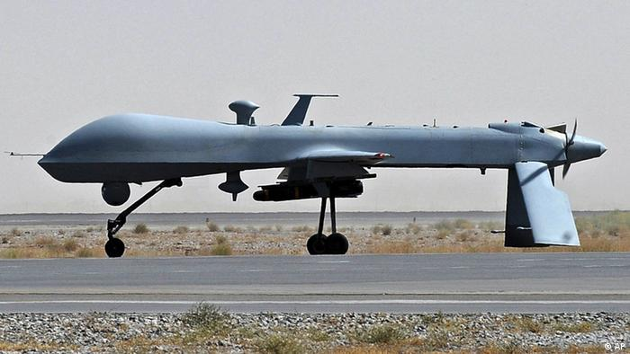 A US Predator unmanned drone armed with a missile stands on the tarmac of Kandahar military airport (Photo: Massoud Hossaini)