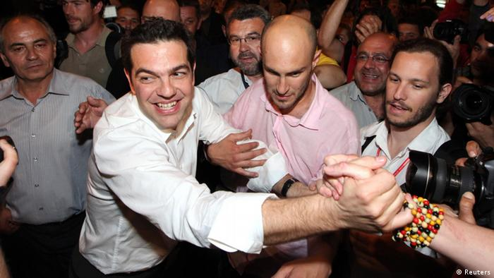 Head of Greece's Left Coalition party Alexis Tsipras celebrates with supporters in Athens late May 6, 2012.