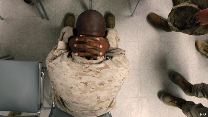 This Sept. 29, 2009 photo shows U.S. Marine Lance Cpl. Greg Rivers, 20, of Sylvester, Ga., holding his neck while waiting to take psychological tests at the Marine Corps Air Ground Combat Center in Twentynine Palms, Calif. The U.S. government is testing hundreds of Marines and soldiers before they ship out, in search of clues that might help predict who is most susceptible to post-traumatic stress disorder. (ddp images/AP Photo/Jae C. Hong)