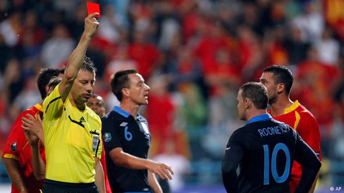 England's Wayne Rooney receives a red card during their group G Euro 2012 qualifying soccer match in Podgorica, Montenegro, Friday, Oct. 7, 2011. (AP Photo/Darko Bandic)