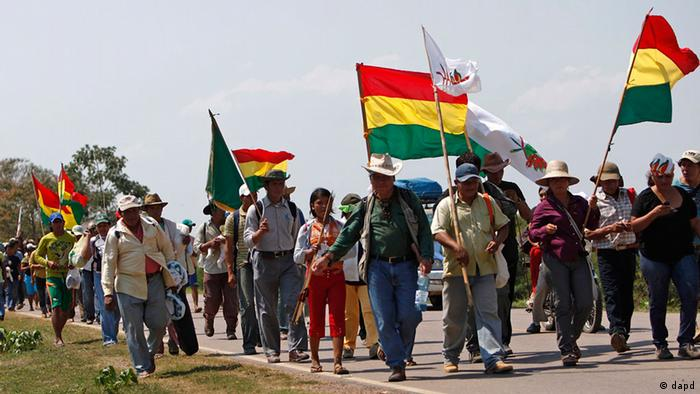 Members of the Moxos ethnic group march during a protest in Bolivia demanding a road through an ecological reserve is not built.