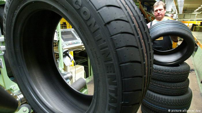Worker checks tires at Continental plant in Hanover, Germany