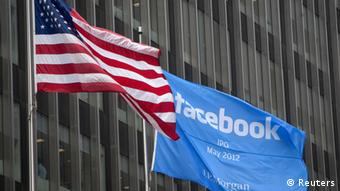 A flag announcing the IPO of Facebook flies next to the American flag outside the offices of J.P. Morgan in New York City, New York May 4, 2012. Facebook Inc aims to raise about $10.6 billion in Silicon Valley's largest IPO, dwarfing the coming-out parties of tech companies like Google Inc and granting the world's largest social network a market value close to Amazon.com's. REUTERS/Lee Celano (UNITED STATES - Tags: BUSINESS SCIENCE TECHNOLOGY)
