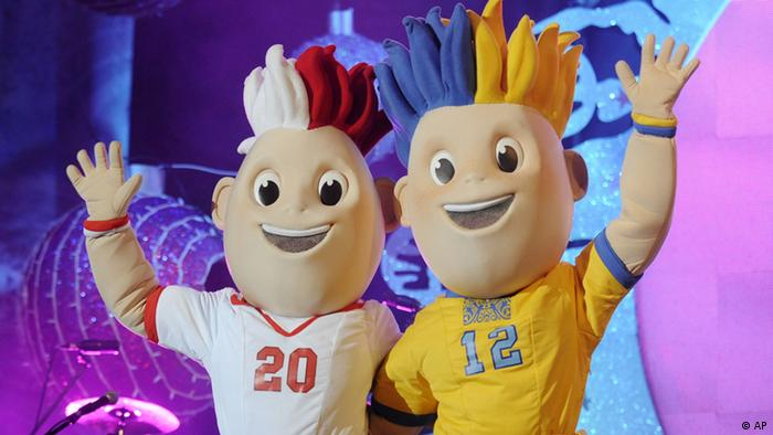 The Euro 2012 soccer championships mascots Slavek, left, standing for Poland, and Slavko for the Ukraine, greet the audience during an open air concert as their names are announced, in Warsaw, Poland, Saturday, Dec. 4, 2010. The names of the mascots for the championships hosted jointly by Poland and Ukraine were chosen in a public vote. (ddp images/AP Photo/Alik Keplicz)