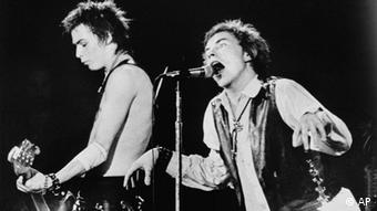 Sid Vicious, left, on bass guitar and Johnny Rotten of the punk rock group The Sex Pistols perform in front of a capacity crowd at San Francisco's Winterland auditorium Saturday night January 15, 1978