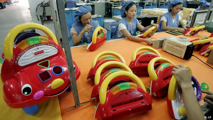 Chinese workers producing toys ddp images/AP Photo/Eugene Hoshiko