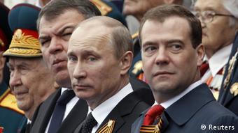 Russian President Vladimir Putin (C), Prime Minister Dmitry Medvedev (R) and acting Defence Minister Anatoly Serdyukov (2nd L) watch the Victory Parade on Moscow's Red Square May 9, 2012. Russia celebrates the 67th anniversary of the victory over Nazi Germany on Wednesday. REUTERS/Sergei Karpukhin (RUSSIA - Tags: POLITICS ANNIVERSARY MILITARY)