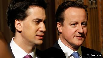 Britain's Prime Minister, David Cameron (R) and opposition Labour Party leader Ed Miliband walk through the Members' Lobby of the House of Commons in Westminster, at the State Opening of Parliament in London May 9, 2012. REUTERS/Stefan Wermuth (BRITAIN - Tags: POLITICS)