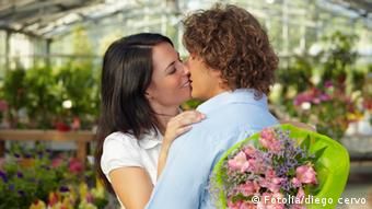 A couple kisses under a tree near the river Rhein meadows in downtown Duesseldorf, Monday Sept. 9,2002, during a sunny and warm period. Weatherforecasters predict the start of autumn with rain and temperatures below 20 deegrees Celsius for the upcoming days in Germany. (AP Photo/Frank Augstein)
