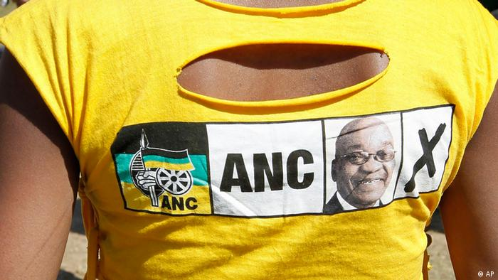 An ANC supporter wears a bright yellow T-shirt with the ANC logo