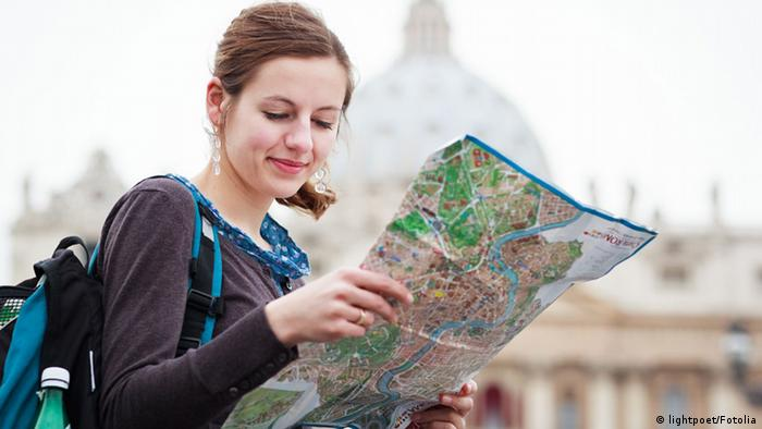 Female tourist studying a map at St. Peter's square © lightpoet #40600070