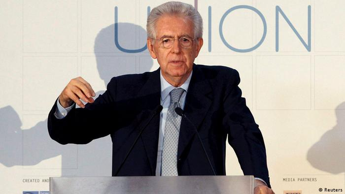Italian Prime Minister Mario Monti gestures as he makes a speech during The State of the Union conference in Florence May 9, 2012. REUTERS/Giampiero Sposito (ITALY - Tags: POLITICS)