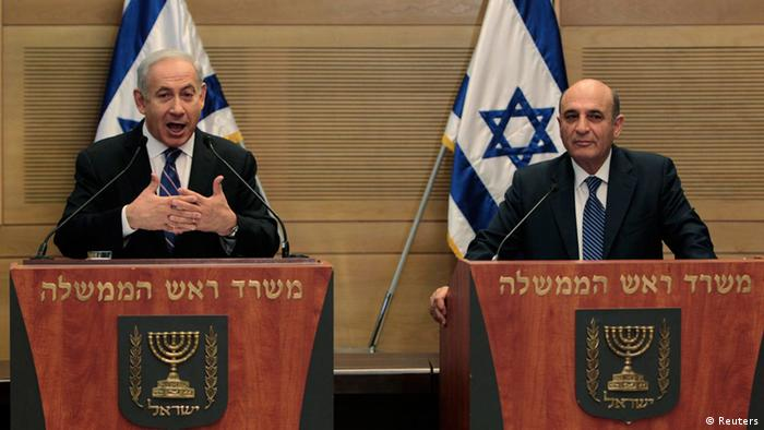 Israel's Prime Minister Benjamin Netanyahu (L) speaks during a joint news conference with Shaul Mofaz, head of the Kadima party which will join Netanyahu's rightist coalition, at parliament in Jerusalem May 8, 2012. Netanyahu formed a unity government on Tuesday in a surprise move that could give him a freer hand to attack Iran's nuclear facilities and seek peace with the Palestinians. REUTERS/Ammar Awad (JERUSALEM - Tags: POLITICS)