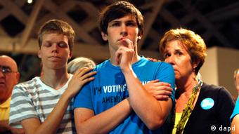 Seth Keel, center, is consoled by his boyfriend, Ian Chambers, left, and his mother Jill Hinton, during a concession speech at an Amendment One opposition party Tuesday, May 8, 2012, at The Stockroom at 230 in downtown Raleigh, N.C.Travis Long/AP/dapd) MANDATORY CREDIT.