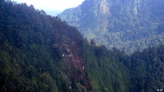 In this photo released by the Indonesian Air Force, the wreckage of a missing Sukhoi Superjet-100 is scattered on the mountainside in West Java, Indonesia, Thursday, May 10, 2012.
