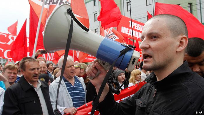 Opposition leader Sergey Udaltsov uses a loud speaker during an opposition rally in downtown Moscow, Sunday, May 6, 2012.