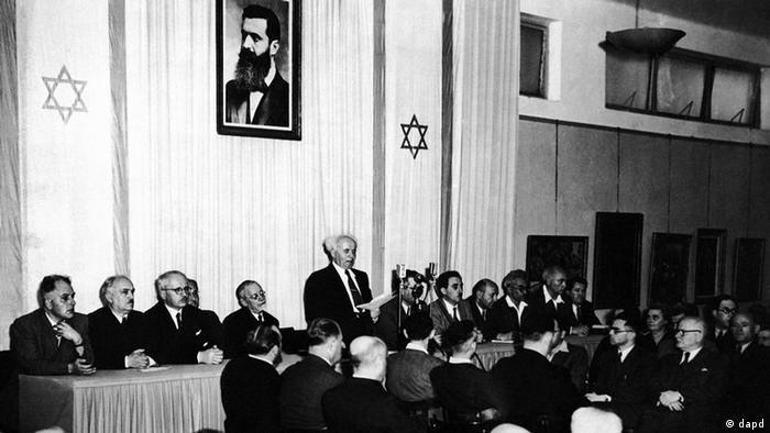 Cabinet Ministers of the new state of Israel are seen on May 14, 1948, at a ceremony at the Tel Aviv Art Museum, marking the creation of the new state. Facing Camera from left are: Baroch Shitrit, Police Commissioner; David Remez, Communications Minister; Fritz Bernstein, Trade, Industry and Suppply; Felix Rosenbluth, Justice; Rabbi Judah Fishman, Commissioner of Jerusalem Area, David Ben Gurion, Premier and Defense Minister speaking; Moshe Shapiro, Director of Immigation; Moshe Shertok, Foreign Affairs; Eliazer Kaplan, Treasurer; Moshe Ben Tov, Public Works and Labor and Aaron Zisling, Agriculture. (ddp images/AP Photo).