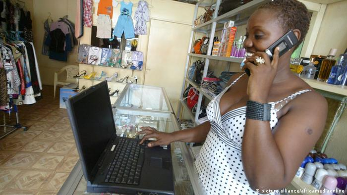 A woman answering her phone in her Boutique in Monrovia. Photo: Africamediaonline