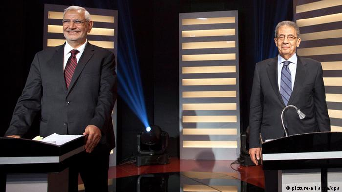 Amr Moussa and Abdel Moneim Abu Futuh during a televised presidential debate in Cairo