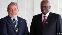 Angola's President Jose Eduardo dos Santos, right, shakes hands with Brazil's President Luiz Inacio Lula da Silva, after dos Santos' arrival at the Brazilian Ministry if Foreign Affairs, in Brasilia, Wednesday, June 23, 2010. Dos Santos is on a two-day official visit to Brazil. (AP Photo/Eraldo Peres)